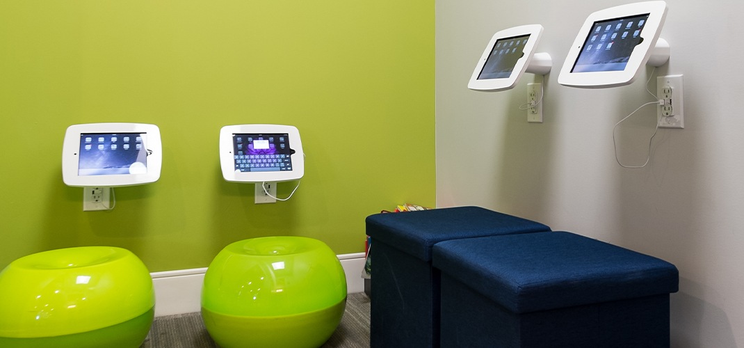 Tablet computers and fun seating in orthodontic office waiting room
