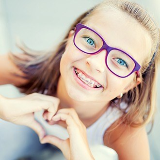 Smiling preteen girl with braces outdoors