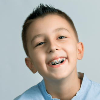 Smiling preteen boy with braces